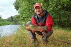 Fisherman and a fish Royalty Free Stock Photo