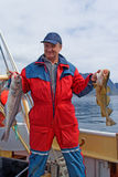 Fisherman with fish on the boat. Near the Lofoten island Royalty Free Stock Photography