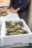 Fisherman at the fish market Stock Photo