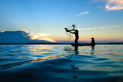Fisherman. Fisher are sown dry river at sunset Royalty Free Stock Photos