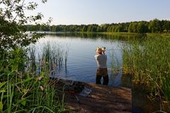 Fisherman. Catching the fish durring sunny day Royalty Free Stock Images