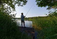Fisherman. Catching the fish durring sunny day Stock Image