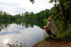 Fisherman. Catching the fish durring sunny day Stock Images