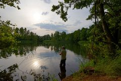 Fisherman. Catching the fish durring sunny day Royalty Free Stock Photography