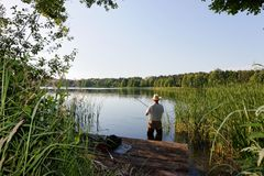 Fisherman. Catching the fish during sunny day Royalty Free Stock Images