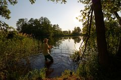 Fisherman. In the lake during sunny day Stock Photos