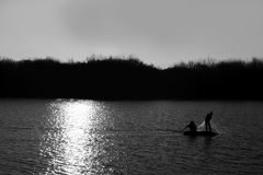 Fisherman. Fishermen in the Murat River. They're keeping their look with a bad release Royalty Free Stock Photo