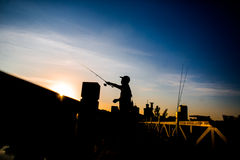 Fisherman fishing. A fisherman fishing on a bridge Royalty Free Stock Images