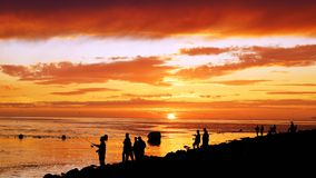Fisherman fishing on the Atlantic Ocean. Royalty Free Stock Image