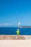 Fisherman fishing in the Atlantic Ocean Royalty Free Stock Photos