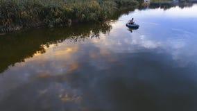 Fisherman fishing from boat stock video