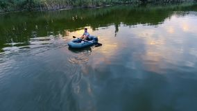 Fisherman fishing from boat stock footage