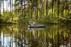 A fisherman in a boat Royalty Free Stock Photography