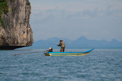 Fisherman fishing from the boat Royalty Free Stock Images