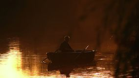 Fisherman fishing boat. Fisherman fishing from boat silhouette stock video