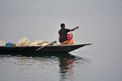 Fisherman is fishing with his boat stock photograph stock image