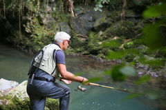 Fisherman with fishing hook beside the river Stock Photos