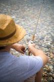 Fisherman fishing at the lake Royalty Free Stock Photos