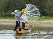 Fisherman is fishing with a large net in a river in Vietnam Stock Images