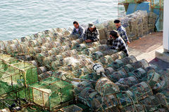Fisherman and fishing net baskets,Cascais,Portugal Royalty Free Stock Images