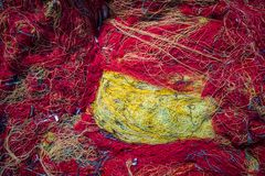 Fisherman fishing net closeup. Tangled colorful fisherman fishing nets on the shore of in Zante Island, Greece royalty free stock images
