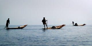 Fisherman fishing with net. On inle lake -myanmar stock photo