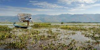 Fisherman fishing with net. On inle lake -myanmar royalty free stock image