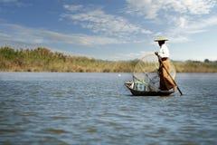 Fisherman fishing with net. On inle lake -myanmar royalty free stock images