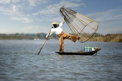 Fisherman fishing with net. On inle lake -myanmar royalty free stock photography