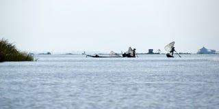 Fisherman fishing with net. On inle lake -myanmar stock image