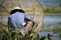 Fisherman fishing with net. On inle lake -myanmar stock photos