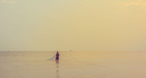 fisherman with fishing net in the sea in Thailand Stock Photography
