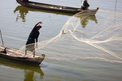 Fisherman fishing with nets in Myanmar Royalty Free Stock Image