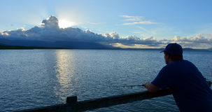 Fisherman fishing in Port Douglas Queensland  Australia Stock Photography