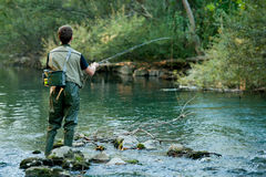 A fisherman fishing on a river. In late summer afternoon Royalty Free Stock Photos