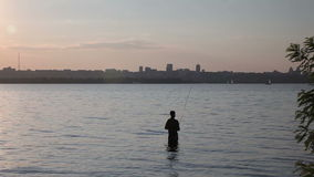 The Fisherman is Fishing on The River stock footage