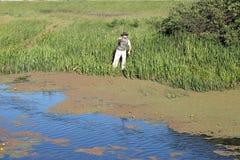 Fisherman fishing on river Royalty Free Stock Image
