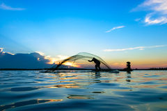 Fisherman. Are fishing the river in Thailand Royalty Free Stock Photos