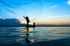 Fisherman. Are fishing the river in Thailand Royalty Free Stock Photography
