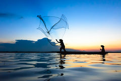 Fisherman. Are fishing the river in Thailand Royalty Free Stock Image