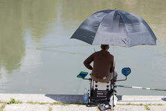 Fisherman fishing in the river Tiber Stock Photo