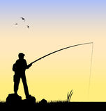 Fisherman fishing in a river vector. Vectored illustration as silhouette of fisherman fishing in a river at sunset Royalty Free Stock Photography