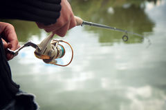 Fisherman with fishing rod Royalty Free Stock Photography