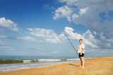 A fisherman with a fishing rod Royalty Free Stock Photos