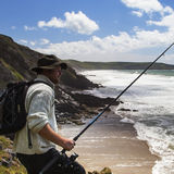 Fisherman with Fishing Rod in Dramtaic Sea Scape - Panorama Stock Photos