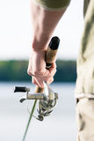 Fisherman with fishing rod in hand - Close-up Royalty Free Stock Photography
