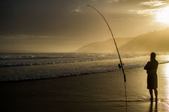 Fisherman with Fishing Rod Holder during Sunset at Wilderness Be. Ach Along the Garden Route in South Africa Stock Image