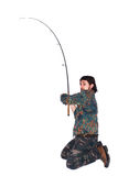 Fisherman with fishing rod Stock Images