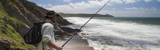 Fisherman with Fishing Rod - Panorama Stock Photography