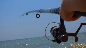 Fisherman with a fishing rod stock video